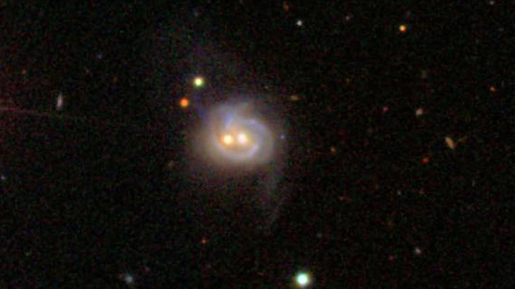 Due buchi neri danzano in una galassia lontana lontana